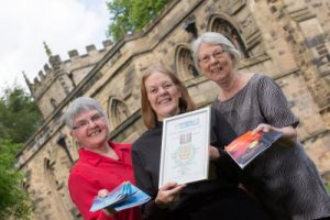 Members of the editorial team Joan Bell, Editor Revd Ruth Thomas and Pat Morgan with copies of the winning magazine and Award of excellence at St Giles Durham